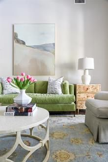 living room design | burl and brass side table | landscape art by karen smidth | green velvet soda | design by blue print interiors | blueprintstore.com