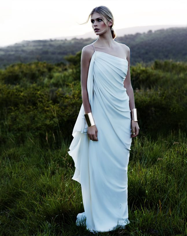 Bridal Dresses UK: Sexy Wedding Dresses By Amanda Wakeley.    With her Grecian gown and the metallic bracelets, Wonder Woman at a wedding, I LOVE it!!!