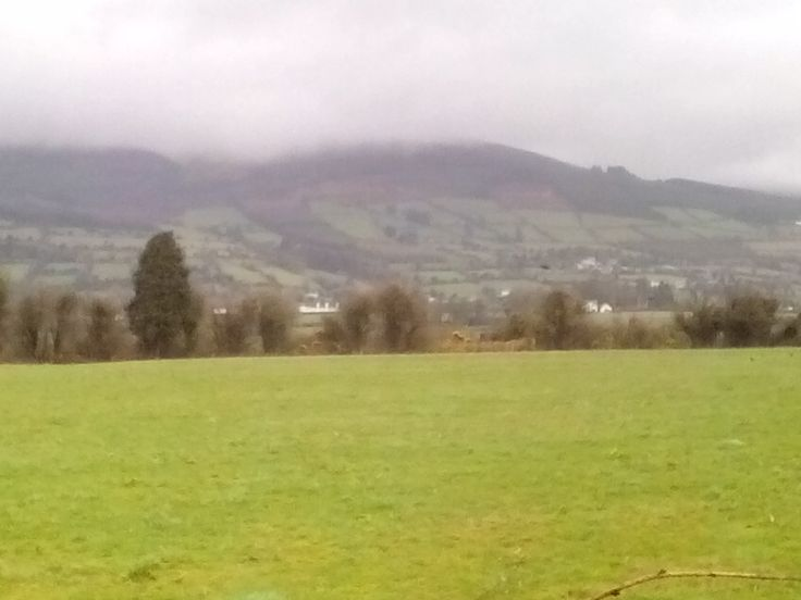 Dark clouds creeping over the Galtee Mountains just outside Mitchelstown, County Cork, Ireland.