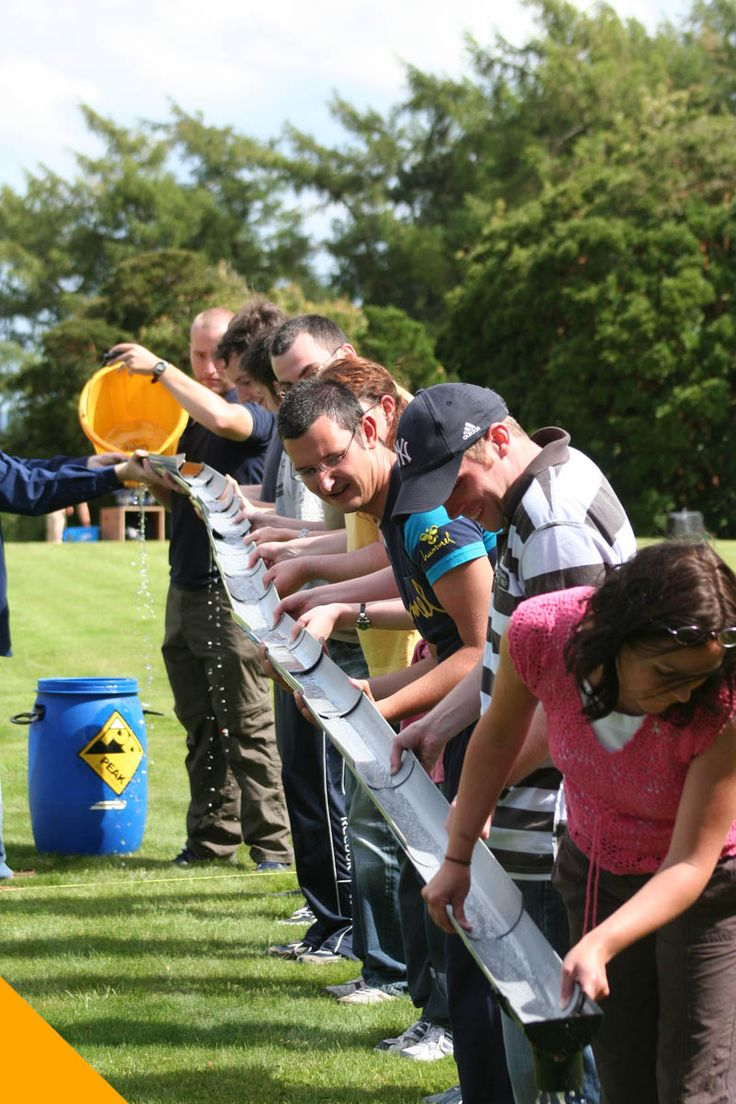 team building games like this are great! one to do is use a bucket and give everyone cups saying they have to transport the bucket of water you are dumping to the other bucket and here is the catch you poor until it is empty slowly and constantly. the team with the most water at the end/most teamwork used wins!
