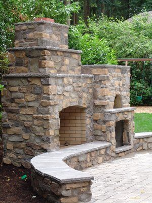 Outdoor living pizza oven, outdoor fireplace, seating by fireplace, columns, patio, stone, cultured stone, wood box, landscape
