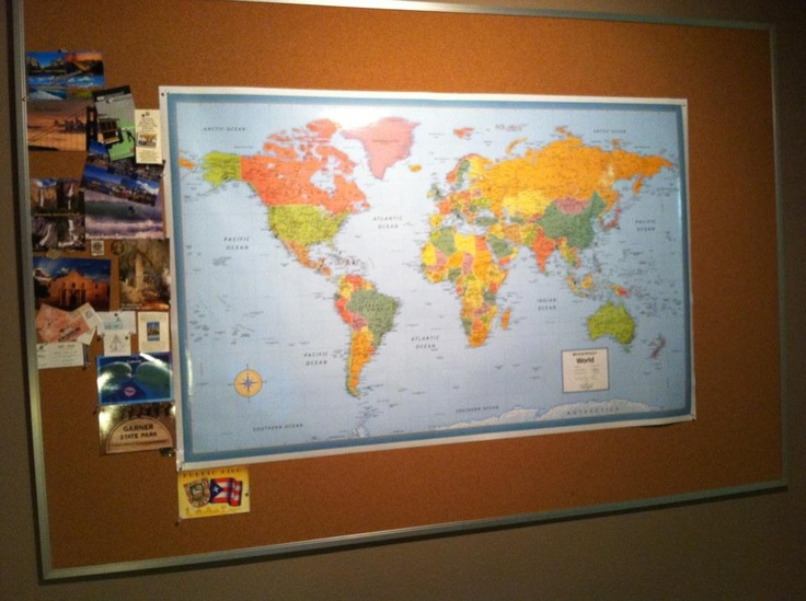We took a world map and tacked it on a cork board.  We placed red pins on the places that we have been and then placed green pins on the places we wanted to go ( we limited ourselves to only picking 6 places each because if we did not the whole map would be covered in green).  When we go to new place (state, country, etc) we get a postcard and a pin and tack it onto the corkboard around the map.  I LOVE this!
