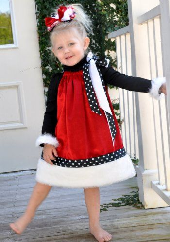 Santa Baby Christmas Pillowcase Dress. Red velvet dress with white fur trim. SO Cute for photos! Pair with a black long sleeve shirt and leggings or tights for cooler weather! The black fur trimmed turtle neck is available for $19.99. Sizes 6 to 9 will be crew neck shirts. Matching Brother outfit also avilable! These items will be shipping in November.