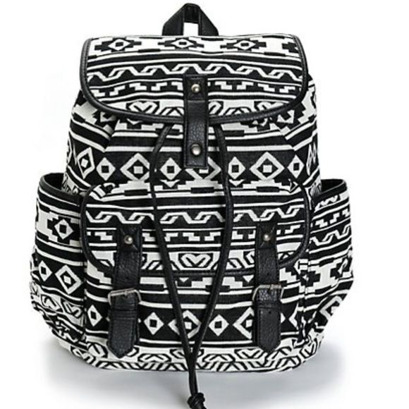 "Black and White Print w Black Trim Rucksack. NWT. Black and white print canvas rucksack backpack with black synthetic leather trim. Taffeta lining with cinch top and magnetic snap closures. Lightly padded adjustable shoulder straps and top handle loop. 14"" H x 15"" W x 6"" D. 60% cotton, 40 % polyester. NWT. Zippered inside pocket for your phone and keys. Bags Backpacks"