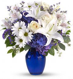Beautiful in Blue - probably FTD since I have this pinned from some other florist elsewhere.  cut the daisies.
