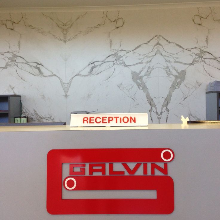 Dekton Aura bookmatched cladding used in the Galvin Hardware reception area