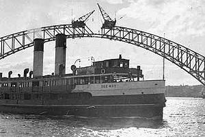 Sydney Ferry Dee Why, passing the unfinished Sydney Harbour Bridge.  I started to travel on the ferry Dee Why in 1964