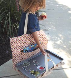 DIY lap tray...tray for drawing and games, attached to a pillow for sleeping and has a fold out compartment that will hold coloring book ect.......awesome present for kids or adults!