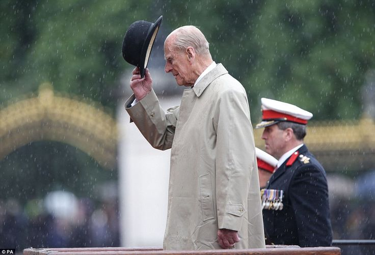 Britain's Prince Philip, in his role as Captain General, Royal Marines, tips his hat to ma...