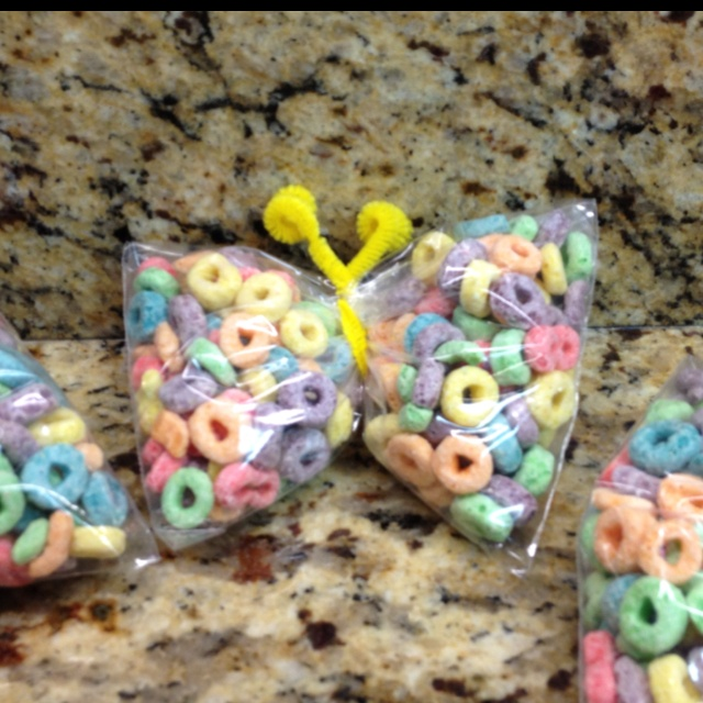 Class snack for preschool. Sandwich size baggies, pipe cleaners, and 12 oz box of Fruit Loops (makes about 10). Fill bags halfway, separate into two equal amounts within the bag and twist pipe cleaner around it to secure. Twist the antennae.