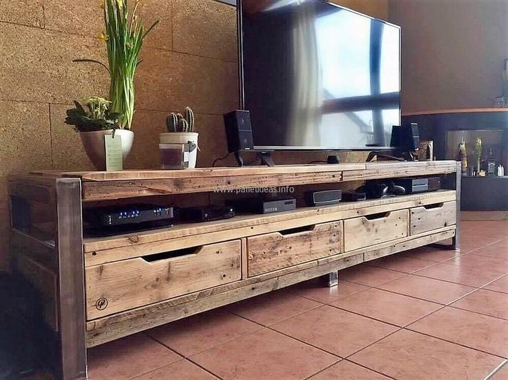 A single furniture piece repurposed wood pallet media console is enough if it is created with the idea presented here because it is huge and it offers a space to place the decoration pieces over it, the items linked to the TV and the drawers for the storage are also present in it.