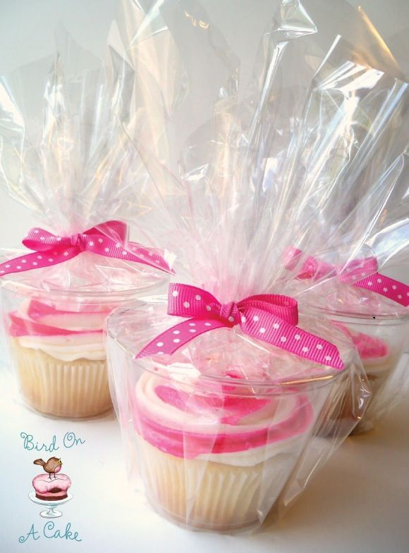 Put cupcakes in those little clear plastic punch glasses and wrap in plastic wrap. Clever alternative instead of purchasing cupcake holders!
