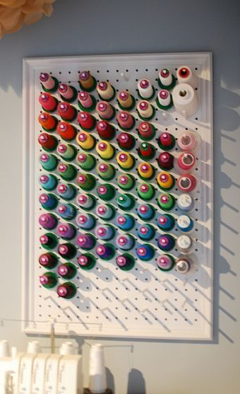 thread storage using framed pegboard and wood dowels...I would maybe paint my pegboard first, or my frame.