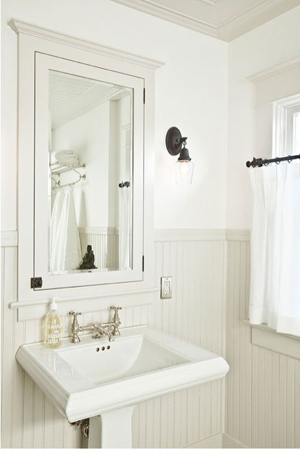 Wainscoting with inset medicine cabinet, Kohler Memoirs Pedestal Sink, Paint is BM AF-685 Thunder at 25%. by Portland, OR–based Jessica Helgerson Design