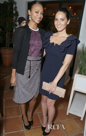 Zoe Saldana posed alongside Olivia Munn at Marie Claire's Hollywood Dinner held at Fig & Olive in West Hollywood, California yesterday evening.