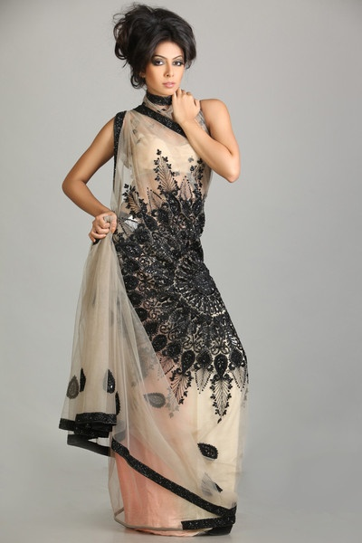 Beige sari with black moti work $570