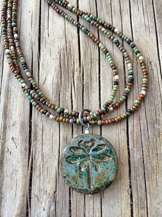 Dragonfly Necklace Dragonfly Jewelry Boho Necklace by Lammergeier, $60.0 Dragon necklace with three beaded strands. Dragonfly pendant made of carved Czech glass with Czech glass beads in reds, greens, turquoise, grey, and oxidized silver. Approximately 17# in length.