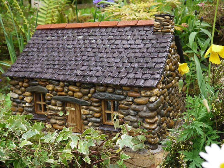 These are adorable miniature cottages and  structures handmade of tiny stones and other material - exquisite!