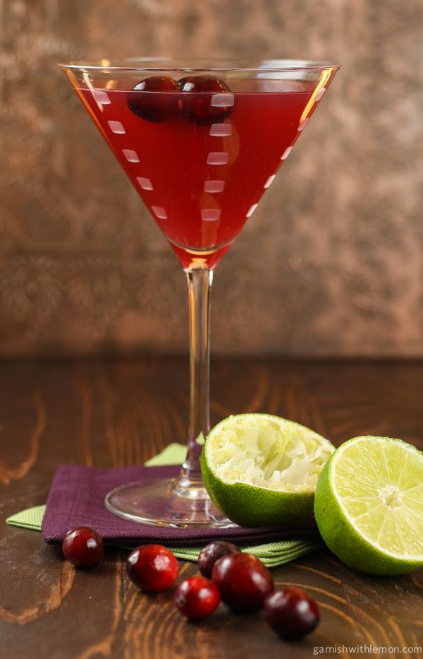 A float of fresh cranberries makes the perfect garnish for this seasonal Cranberry Gimlet  cocktail. Cheers!