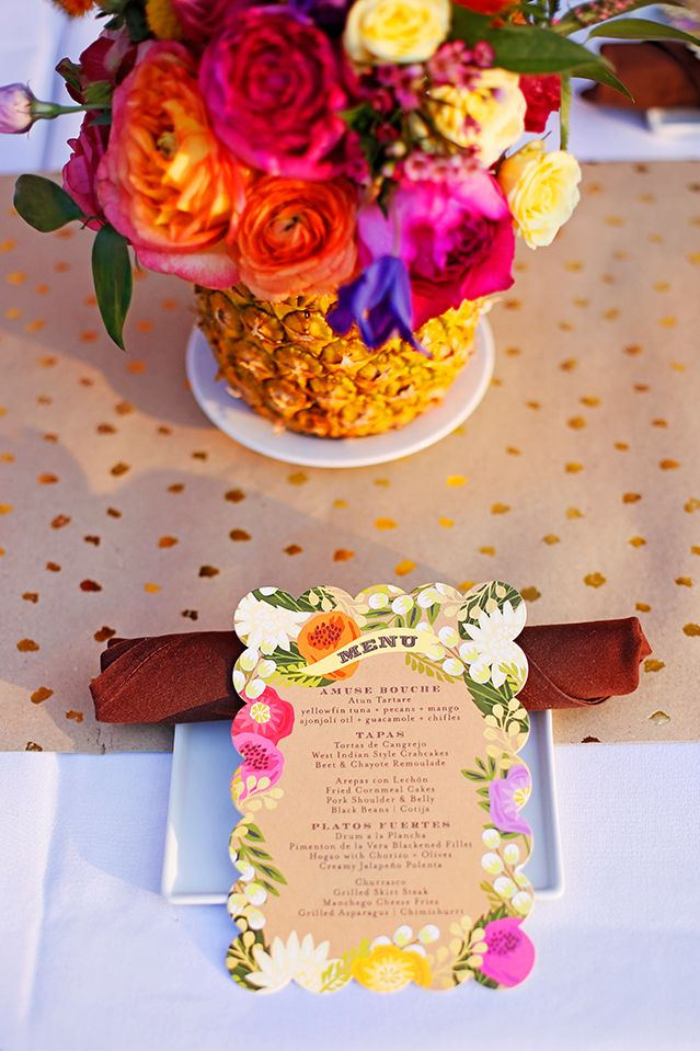 A hot hued Caribbean themed party with pineapple floral centerpiece and floral menus. Via APinchofLovely.com.