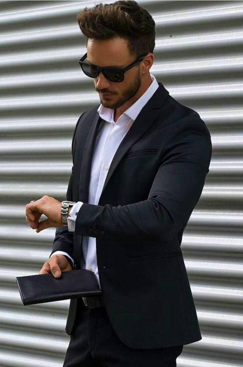 Temper your black suit with a gray coat and a colored scarf. How to Wear a Black Suit With Style