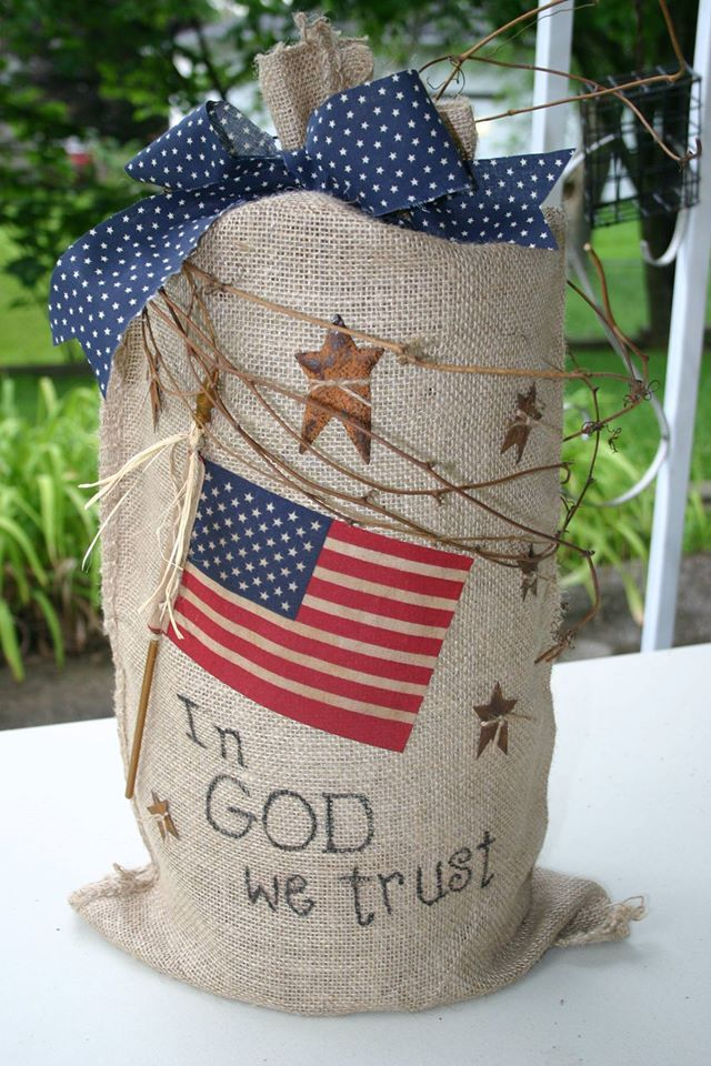 Burlap bag with red, white, and blue lights.
