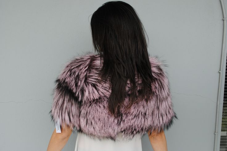 Get yourself immersed in the colour culture of fur with this edgy pink coloured small fox vest.