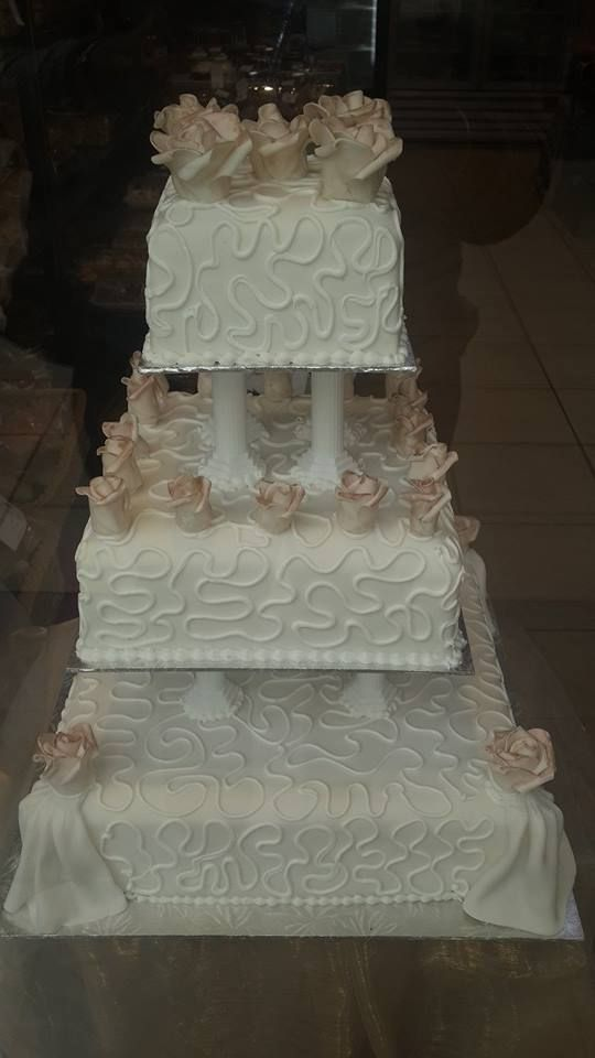 3 Tier square white wedding cake with detailed hand made flowers by Altefyn Cakes