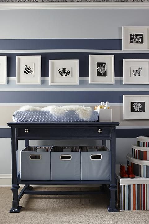 not for a nursery but the wall stripes would make a great accent wall. really makes the white frames POP