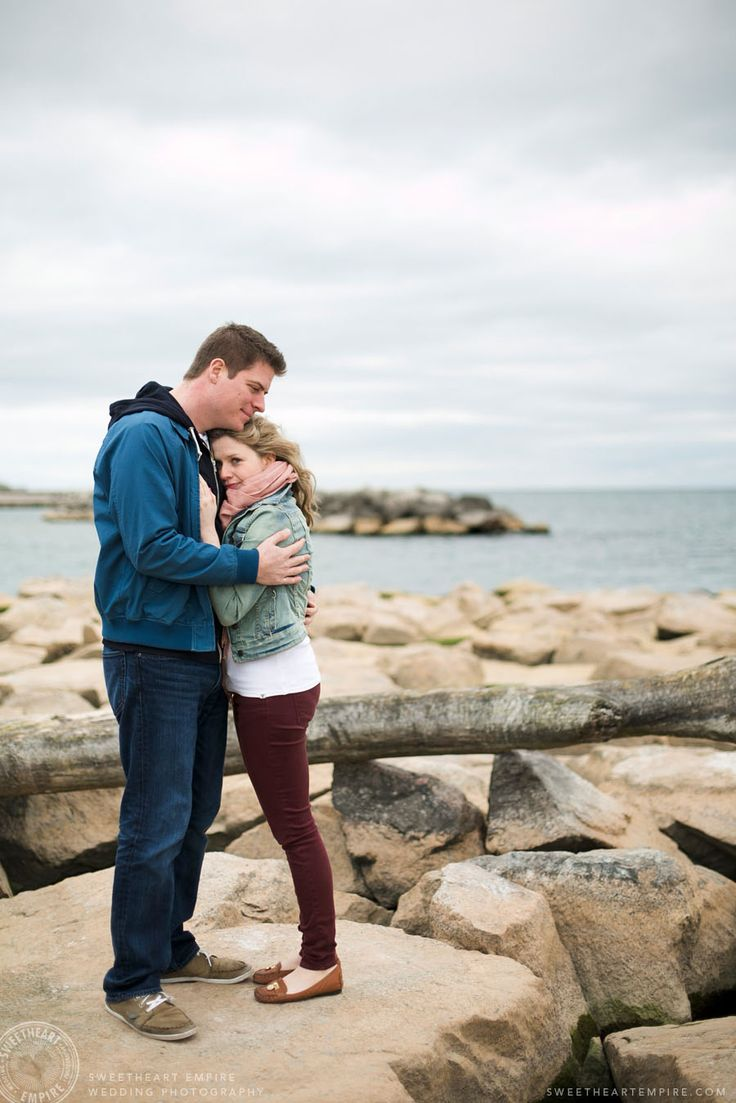 Snuggling by the water, in the Beach neighbourhood. Toronto Beaches engagement photos. #sweetheartempirephotography