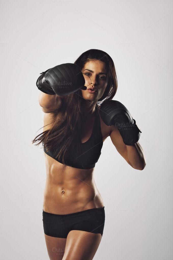 Female athlete exercising boxing by Jacob Lund Photography ...