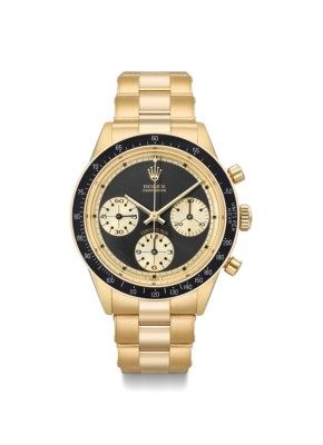 """Rolex. A fine, extremely rare and attractive 18K gold chronograph wristwatch with black """"John Player Special Paul Newman"""" dial SIGNED ROLEX, COSMOGRAPH, DAYTONA, PAUL NEWMAN JOHN PLAYER SPECIAL MODEL, REF. 6241, CASE NO. 1'947'394, CIRCA 1968 Price realised CHF 305,000 Estimate CHF 150,000 - CHF 300,000"""