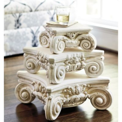 The elaborately scrolled design for this decorative pedestal is based on a classical Ionic column developed by the Greeks and later adopted by the Romans and much of the ancient world. Use our Greco-Roman pedestal to display found objects, plants or pile it high with books. $49.00 - $89.00 Ballarddesigns.com
