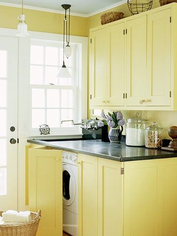 Make the laundry room disappear! Custom-built yellow cabinetry conceals these appliances. http://media-cache8.pinterest.com/upload/56787645271460008_k0gBLkn0_f.jpg bhg lovely laundry rooms