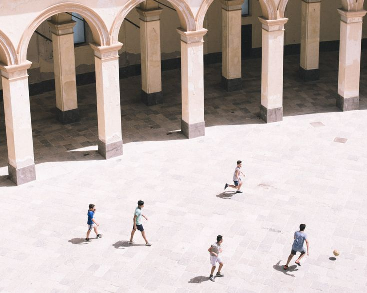 M i n u t e s – Boys playing football at the fishmarket of Trapani, Italy, June 2016.