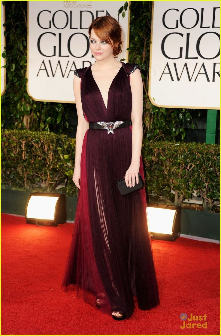 Emma Stone in Lanvin. I'd prefer a different belt, but I LOVE everything else. The capped sleeves, how flowy the dress is, and the thigh slit. As a petite, it's hard to pull off long dresses especially with these layers of fabric, so showing a bit of your legs will never hurt.