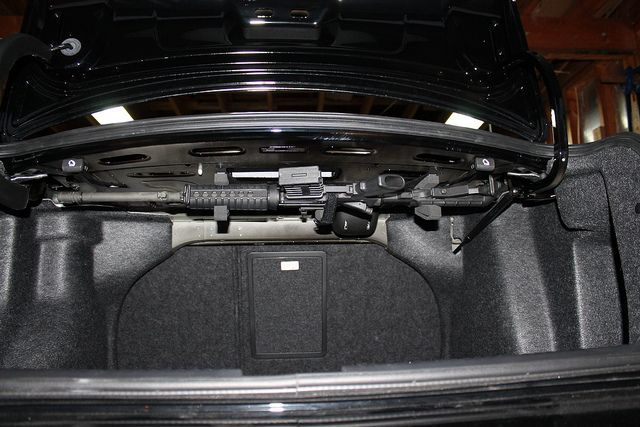 Wanna hide a gun in your car trunk storage setup bug for Mercedes benz car trunk organizer