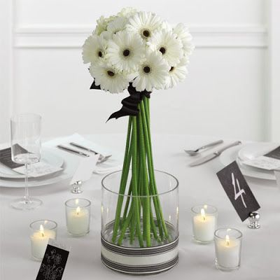 These white Gerbera daisies with a dark center are perfect for a black and white themed event! Gerbera Daisies are available year-round at GrowersBox.com.: Gerber Daisies, Gerbera Daisies, Flower Centerpieces, Centre Pieces, Simple Centerpieces, Wedding Flower, Wedding Centerpieces, Simple Wedding, Center Pieces