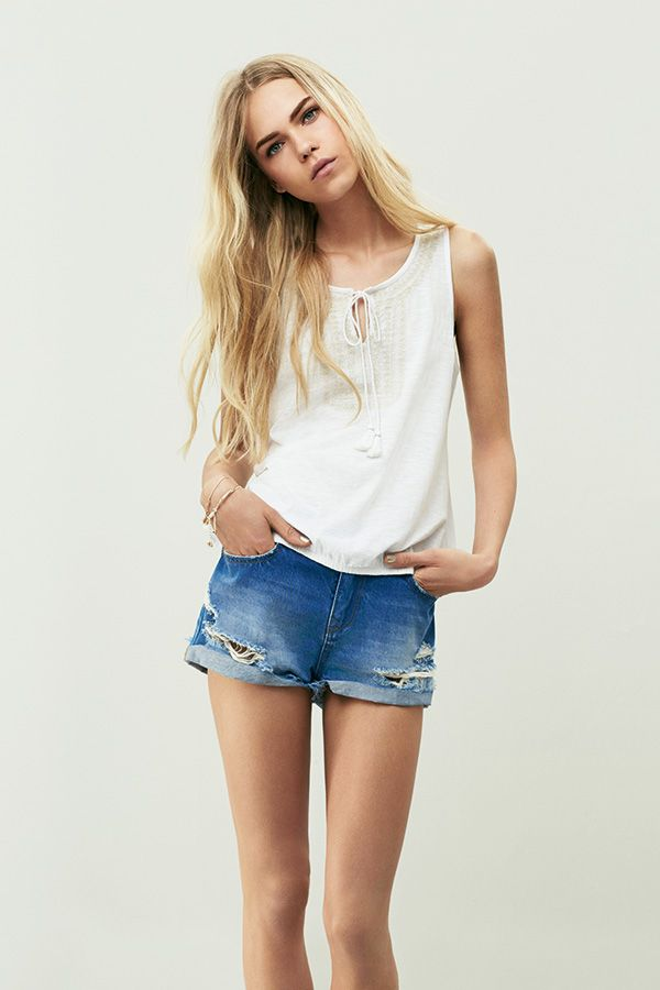 It's a simple look that never fails to look effortlessly stylish at home or on the beach - a white top and denim short combo. #newlook #fashion