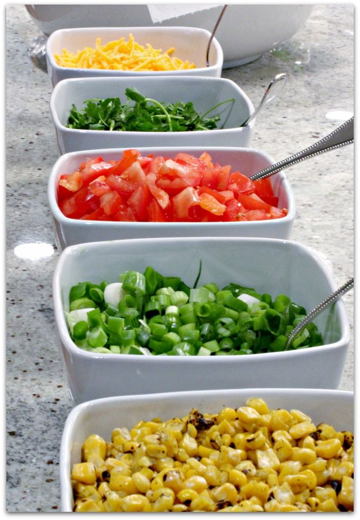 A taco bar is a great way to feed guests.  We always provide a couple different types of meat (ground beef and pulled chicken are the most popular) and loads of veggies and toppings for fabulous tacos and salad.  Using white or glass bowls make a beautiful display for fresh ingredients.