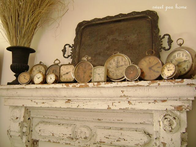 lovely old gems and throw in a old silver tray for good measure   {vintage, clocks, mantle, chippy paint}