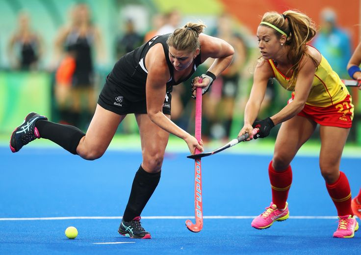 Olivia Merry of New Zealand is challenged by Gloria Comerma of Spain during the Women's Pool A Match between Spain and New Zealand on Day 5 of the Rio 2016 Olympic Games at the Olympic Hockey Centre on August 10, 2016 in Rio de Janeiro, Brazil.