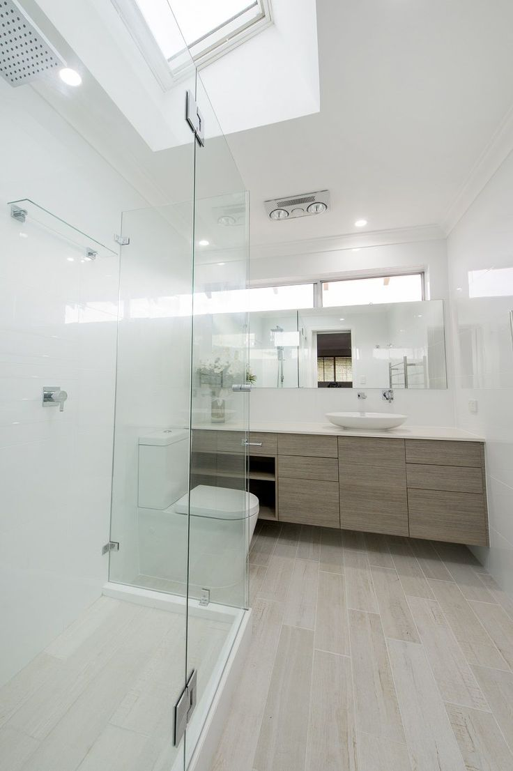The bathroom of this North Perth residence underwent extensive remodelling and renovation by WA Assett - The Bathroom Renovators. Removing the existing window and replacing it with a highlight window allowed for relocation of the vanity and made the bathroom a more usable space. To bring in more light and allow additional ventilation, a VELUX S01 Electric Opening Skylight was installed over the shower. VELUX Skylights Perth