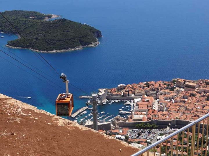 A cable climbs high above Dubrovniks old city.