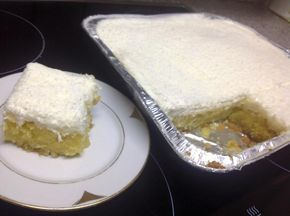 Yλικά  Για την βάση  1+1/2 κούπα ινδική καρύδα  1+1/2 κούπα φαρίνα  1 κουτ. γλυκου μπέικιν  2/3 κούπας βούτυρο  1 κούπα ζάχαρη  3 αυγά  ...