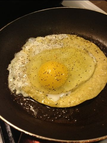 Dr. Phil's Sunday Eggy Thing.. use corn or flour tortilla drizzle with evvo and brown tortilla.. crack eggs on top.. --dr phill added soy sauce..