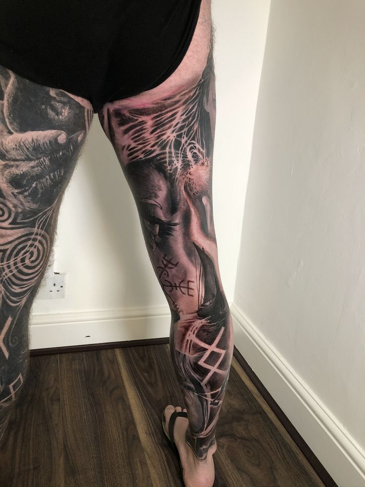 Black and grey realistic full leg tattoo of norse woman