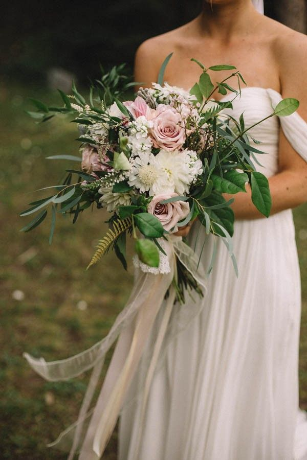 "Breathtaking Canadian Elopement at Lake Louise.  Beautiful Bridal bouquet featuring eucalyptus leaves, flat fern, mauve roses, white stock, salal leaves, ""pincushion"" scabiosa and white veronica."