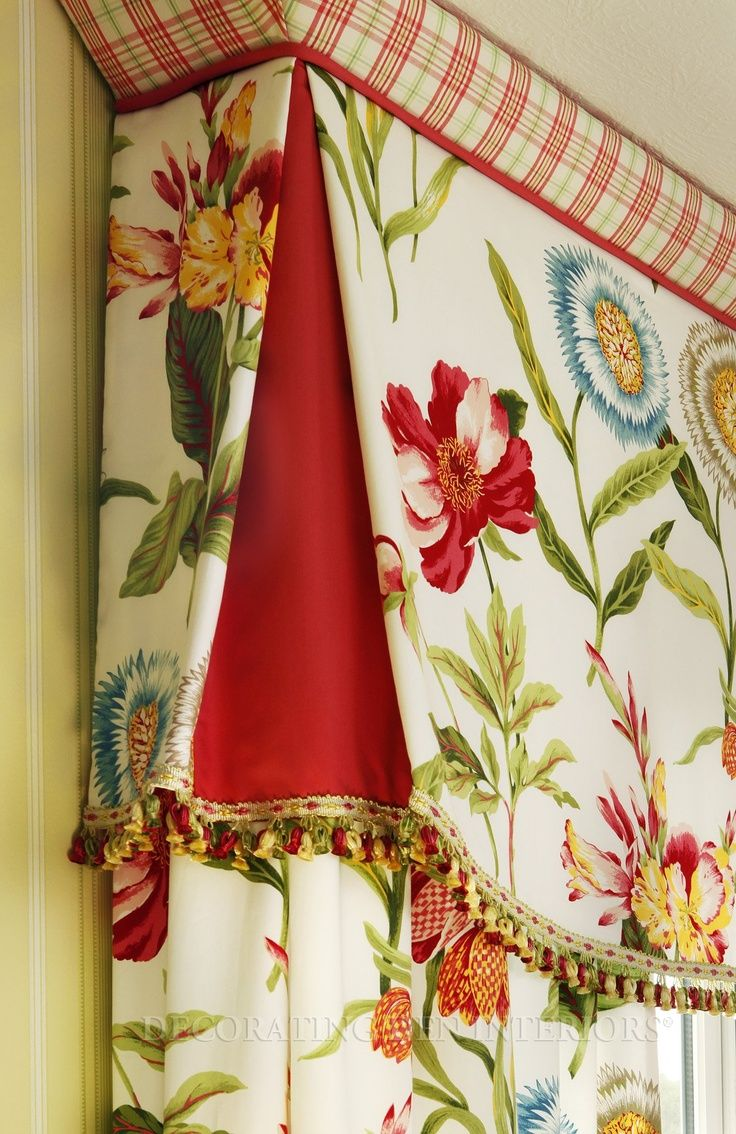 Shaped flat valance with contrasting pleats and angled band across top. Decorative trim along the bottom to finish the valance.