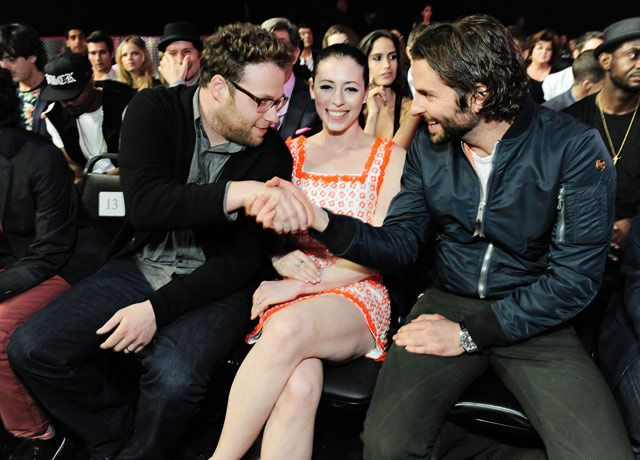 Seth Rogens wife Lauren Miller just smiled as her hubby caught up with Bradley Cooper at the MTV Movie Awards held at the Sony Pictures Studio Lot in Culver City, Calif. April 14.